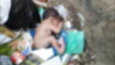 صورة امرأة ترمي طفلين في حاوية قمامة بالأردن